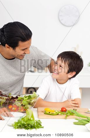 Happy Father Helping His Son In The Kitchen