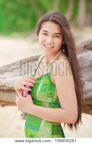Beautiful Teen Girl Holding Cellphone , Smiling On Hawaiian Beach