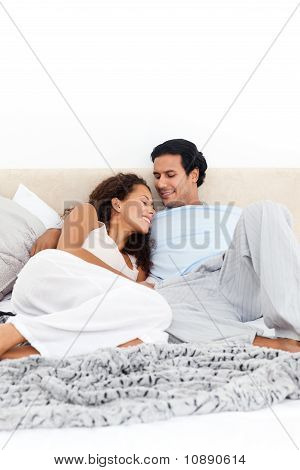 Passionate Couple Lying Together On Their Bed