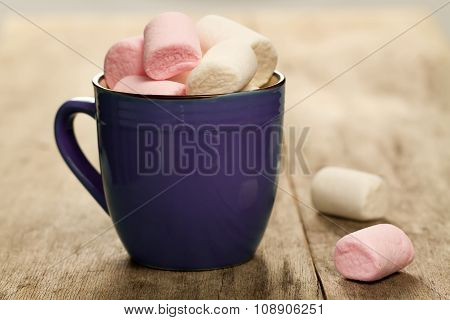 Sweet Colorful Marshmallow In A Cup On Wooden Background