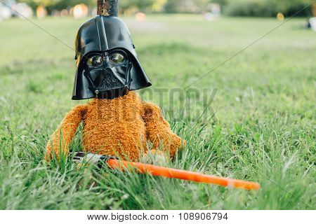 Teddy Bear In A Mask Of Darth Vader With Sword.