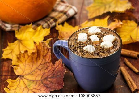 Cup Of Hot Chocolate With Cinnamon And Marshmallows On Wooden Background. Autumn, Pumpkin, Maple Lea