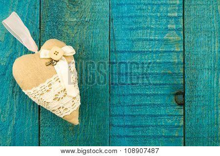 Vintage Heart On Old Blue Wooden Background