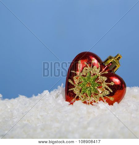Christmas Composition With Red Ball In The Snow