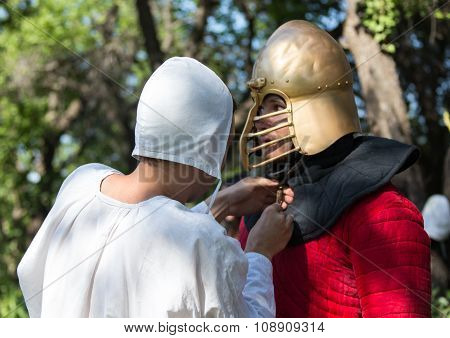 Glistening Knight holding handed sword