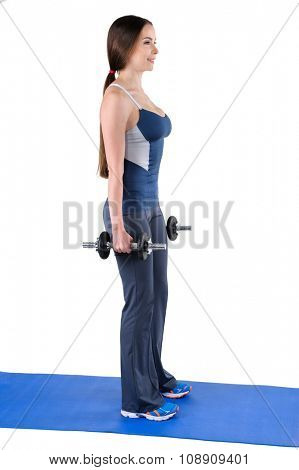 Young woman shows starting position of Standing Dumbbell Squats workout, isolated on white