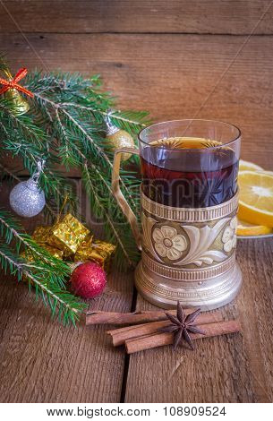 Christmas and new year decoration, tea in vintage glass with coaster