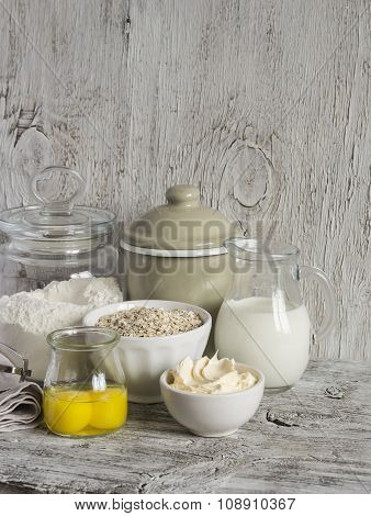 Ingredients For Baking - Flour, Milk, Butter, Eggs On A Light Wooden Table. Free Space For Text.  Fo