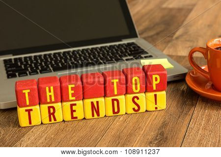The Tops Trends written on a wooden cube in a office desk