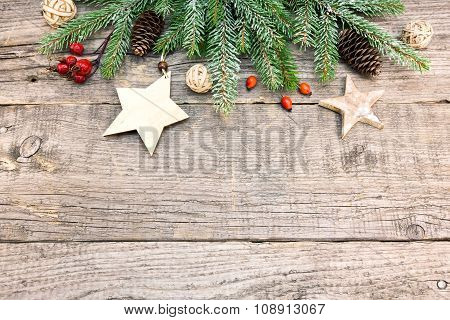 Christmas Fir Tree Decoration On Rustic Wooden Board With Copy Space