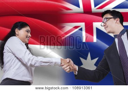 Australian Man Shaking Hands With Indonesian Woman