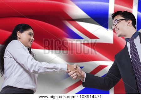 British Businessman Shaking Hands With Indonesian Woman
