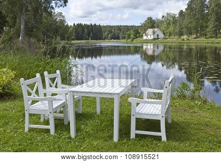 White wooden outdoor furniture.