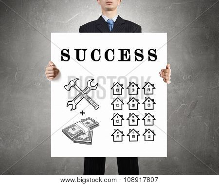 Businessman holding banner with drawn money earning concept
