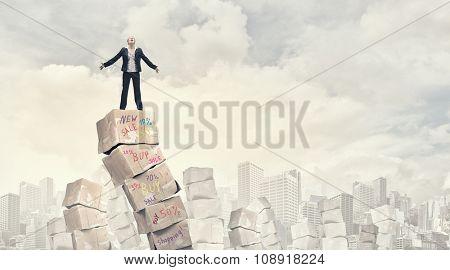 Businesswoman screaming among pile of carton boxes