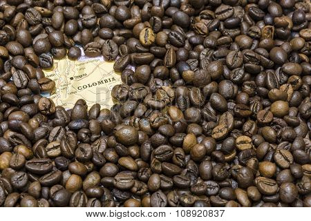 Map Of Colombia Under A Background Of Coffee Beans