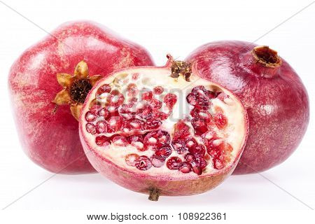 Some Fruits Of Red Pomegranate Isolated On White Background