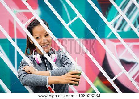 Sporty Woman Drinking Detox Smoothie