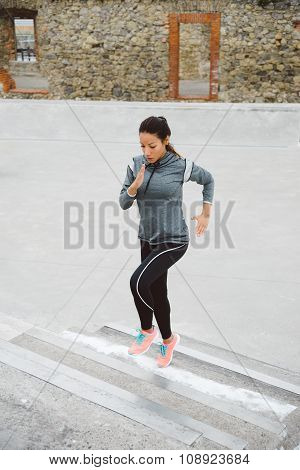 Woman Running And Climbing Stairs