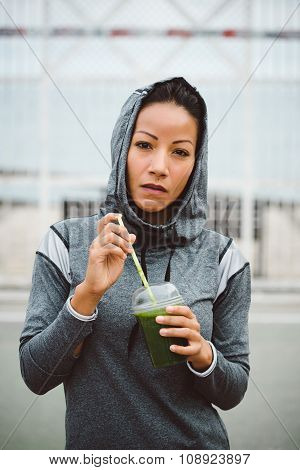 Urban Fitness Woman Drinking Detox Smoothie On Workout Rest
