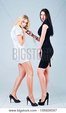 Studio Fashion Shot: Competition Of Two Lovely Women (blonde And Brunette)