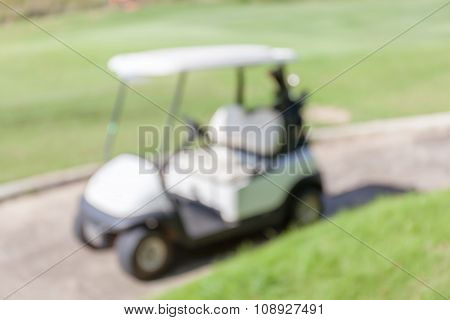 Blurred Photo Of Golf Cart Parks Around Golf Course Service Standby For Golfers.