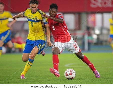 VIENNA, AUSTRIA - SEPTEMBER 9, 2014: Albin Ekdal (#8 Sweden) and David Alaba (#8 Austria) fight for the ball in an European Championship qualifying game.