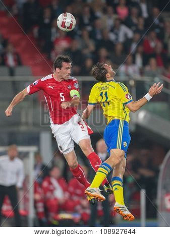 VIENNA, AUSTRIA - SEPTEMBER 9, 2014: Christian Fuchs (#5 Austria) and Johan Elmander (#11 Sweden) fight for the ball in an European Championship qualifying game.