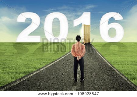 Male Worker Looking At Numbers 2016 On The Road