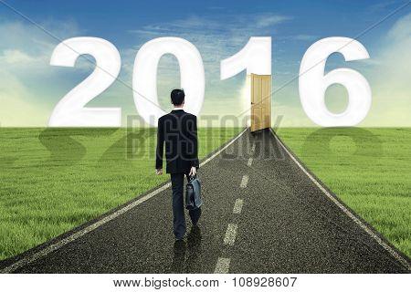 Male Worker Walks Toward Number 2016