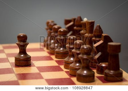 wooden chess board and pieces on a black background