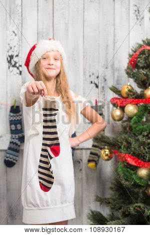 Teenage girl showing New Year and Christmas socks