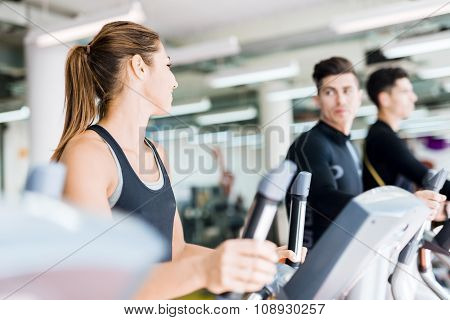 Beautiful Fit Young Woman Working Out On A Stepper