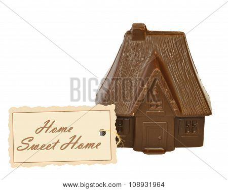 Chocolate House and card with text Home Sweet Home, on white background