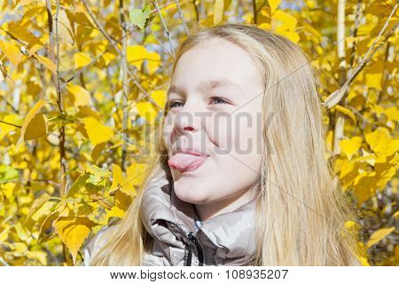 Cute Girl In Sunlight Put Out Tongue