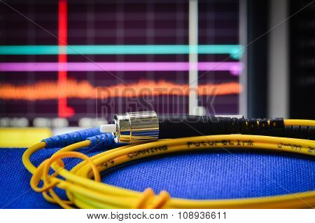 Fibre Optic Cable With Spectrum Analyser In The Background