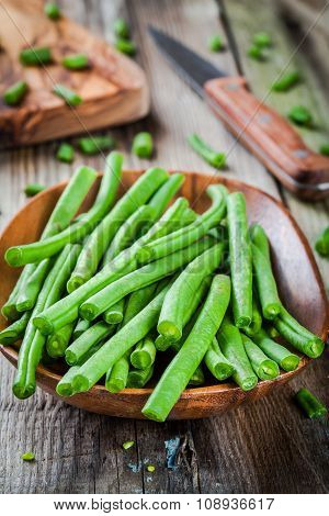 Pods Of Fresh Organic Green Beans In A Wooden Bowl Closeup