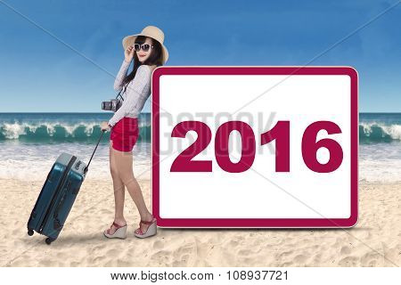 Tourist With Number 2016 At The Beach