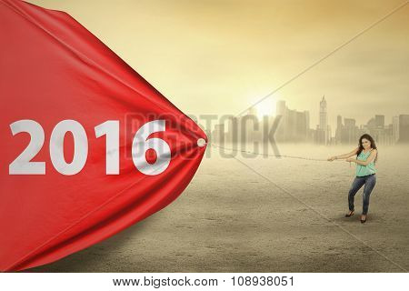 Woman Dragging Red Flag With Numbers 2016