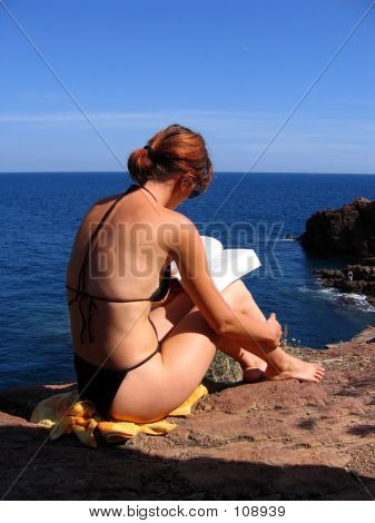 Reader On The Rock
