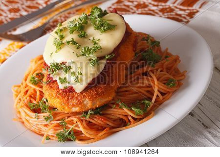 Italian Chicken Parmigiana And Pasta Close Up On A Plate. Horizontal