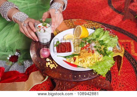 Hands Of The Indian Woman And Nearby On A Table The Indian Dish