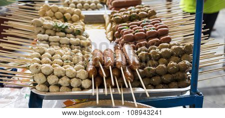 Grilled Thai Sausages On The Stove In The Boat At Traditional Market, Thailand