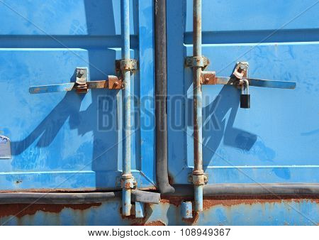 Rusty Lock Mechanism On Blue Container Closeup