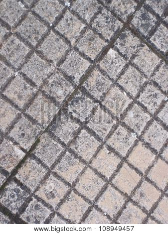 parallel line pattern on pavement tiles