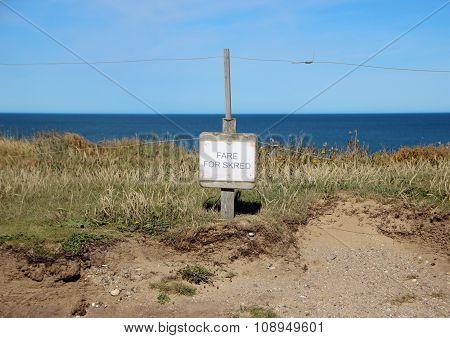 Danish Sign At Edge Of Cliff Warning Of Erosion