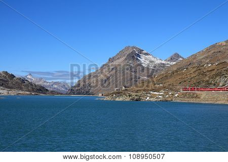 Train On The Bernina Pass And Turquoise Lake Blanc