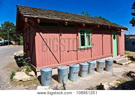 GRAND CANYON, USA - MAR 7, 2008: wooden house with litter boxes made of tin per weekday in Grand Canyon Village