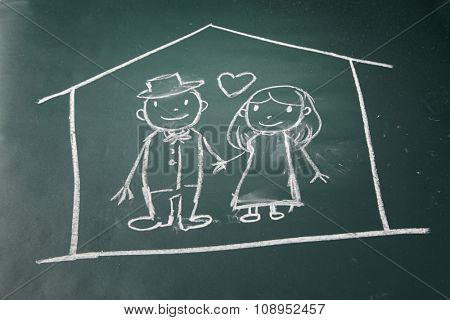 drawing on the chalkboard husband and wife in love protected in a house