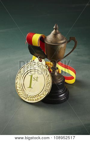 medal and trophy on the blackboard